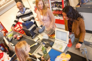 High angle view of cashier with a line of people at the check-out counter